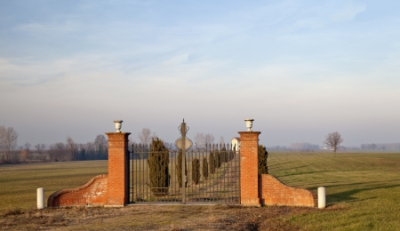 Outside gate of entrance to a far villa photo