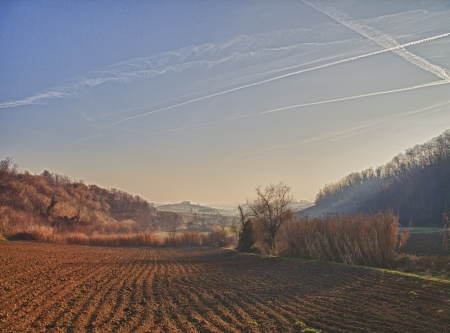 A landscape of fields, at sunset light Stock Photo - 17123129