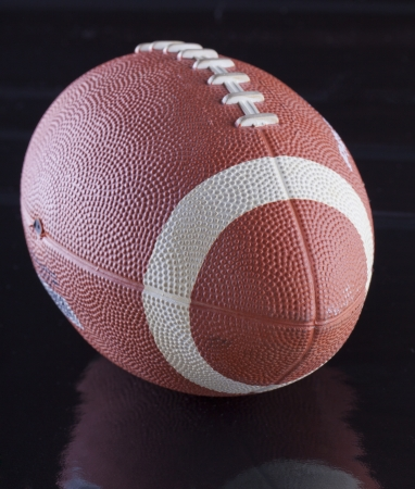 View of a football over a black surface