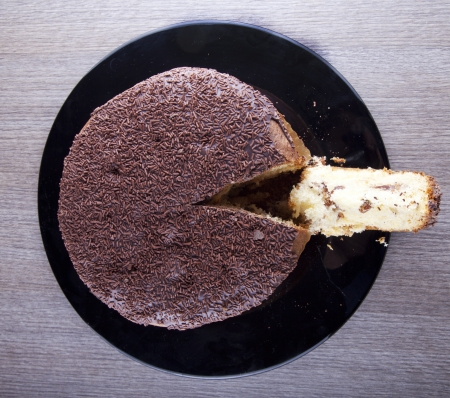 View from above of a chocolate cake with a cut slice Stock Photo - 17292065