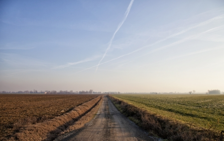 Road cutting through the fields, at the sunset Stock Photo - 17291763