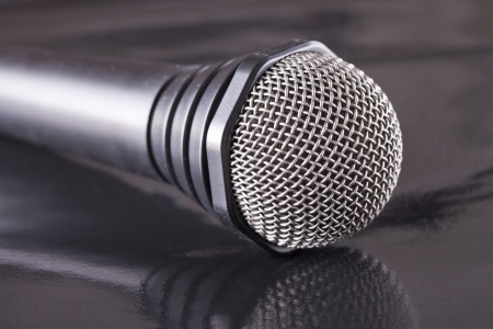 A Microphone over a black reflecting surface Stock Photo - 17292078