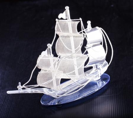A metallic little ship over black background photo