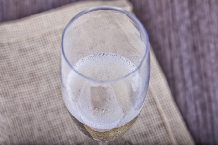 Close up of a glass of spumante over a table Stock Photo - 17836450