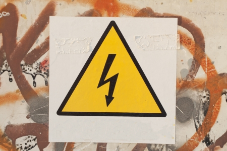 A danger signal over a painted wall Stock Photo - 18403566