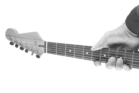 Black and white image of a neck of an electric guitar with male hand photo