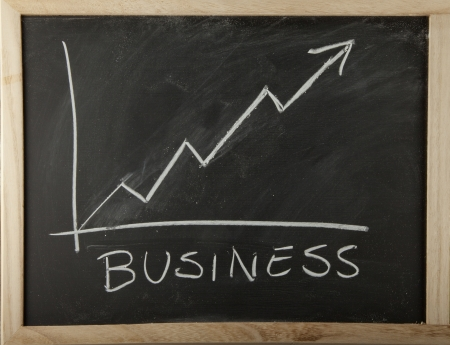 A blackboard with graph of increasing business Stock Photo - 18993285