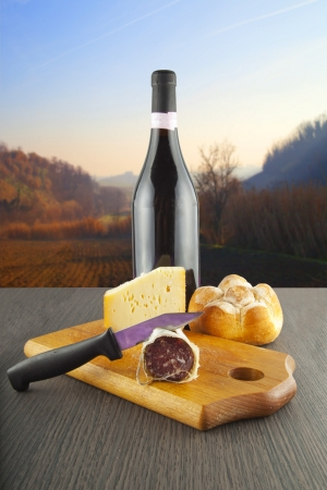 Table with sausage, cheese, bread and wine photo