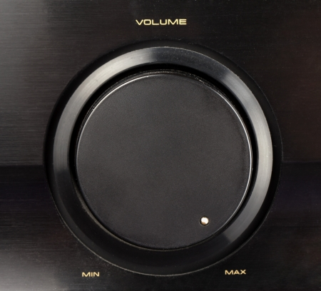 A black knob of volume turned to max Stock Photo