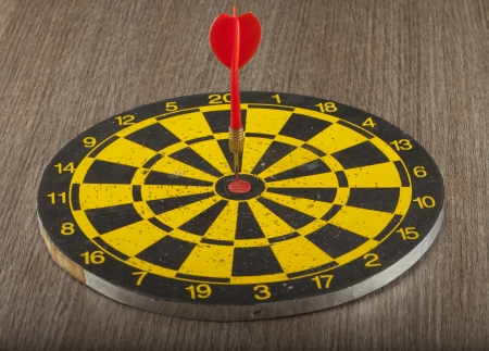 A black and yellow target with arrow on the center