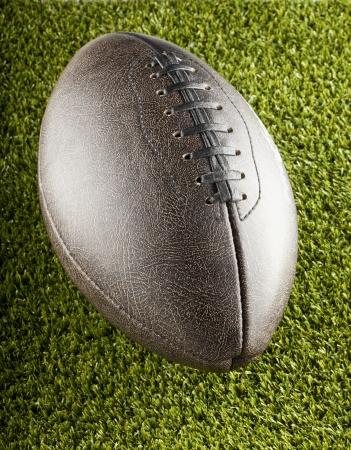 pigskin: Close up of brown dark old football