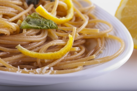 Close up of a plate with spaghetti with lemon Stock Photo