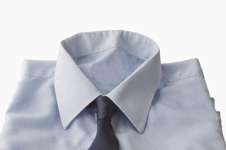 High part of a blue shirt with tie isolated over white photo