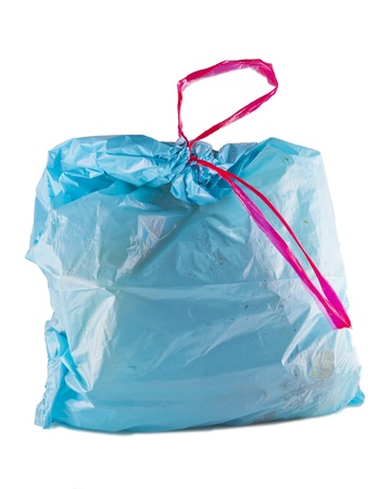 A full blue sack for junk isolated over white photo