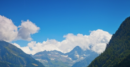 View of mountains under blue sky with clouds photo