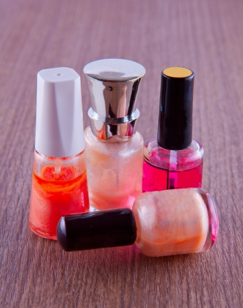 maquillage: Four little bottle for feminine maquillage over table Stock Photo