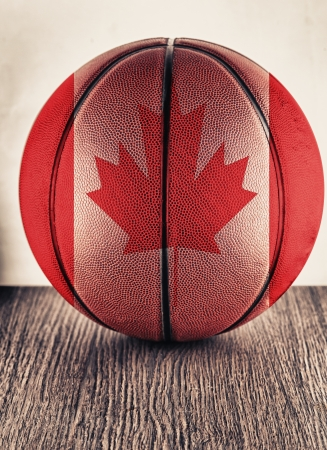 Close up of an old leather basketball with Canada flag photo