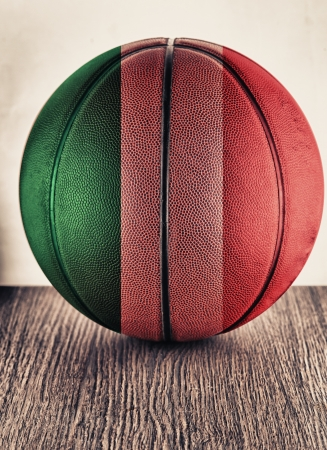 Close up of an old leather basketball with Italian flag photo