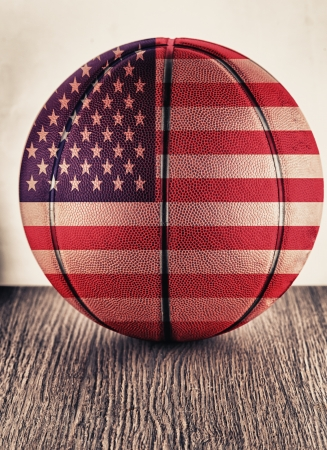 Close up of an old leather basketball with USA flag photo