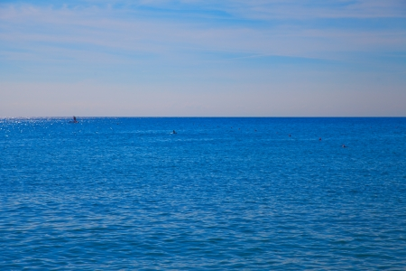 A full view of deep blue sea under blue sky photo