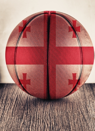 Close up of an old leather basketball with Georgia flag photo