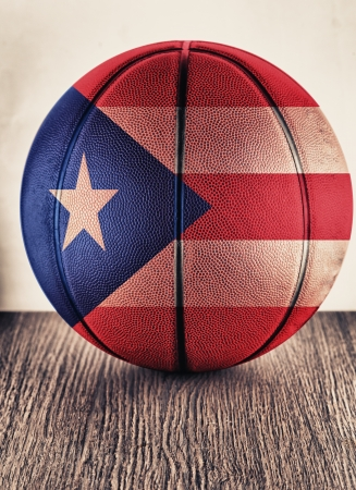 puertorico: Close up of an old leather basketball with Puertorican flag Stock Photo