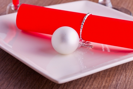 Red Christmas menu with bauble over white photo