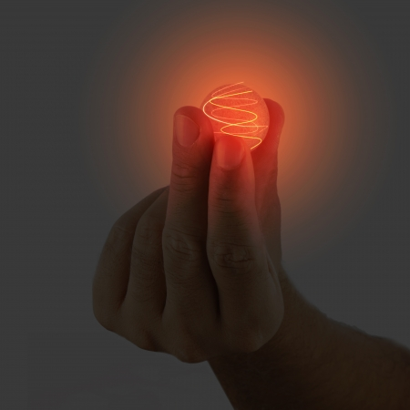 supernatural power: Glowing sphere held in a male hand Stock Photo