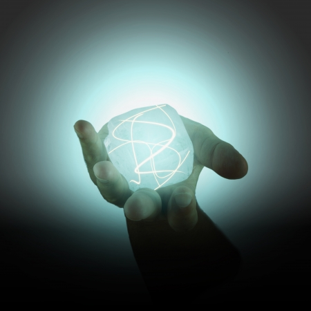 Power cube with lights held in a male hand