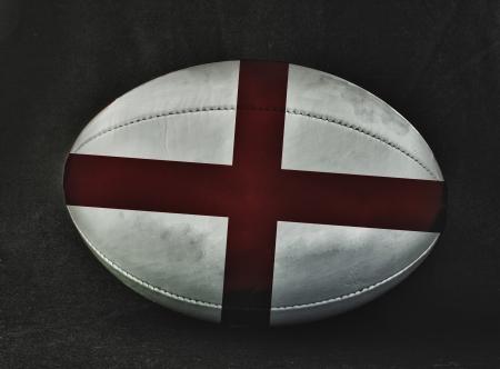 pelota rugby: Pelota de rugby con colores de la bandera de Inglaterra, sobre fondo negro