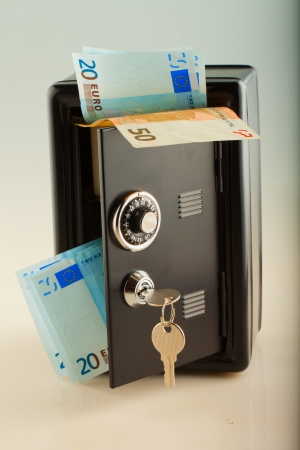 strongbox: Strongbox full of euros, over white background Stock Photo