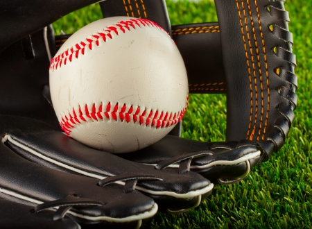 A baseball inside a baseball glove over white background photo