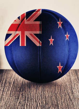 Close up of an old leather basketball with New Zealand flag photo