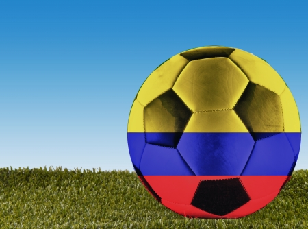 A football over grass decorated with Colombia flag photo