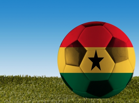 ghanese: A football over grass decorated with Ghana flag