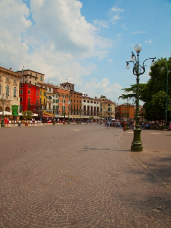 gorgeus: Italian piazza with gorgeus buildings and many blurred people Stock Photo