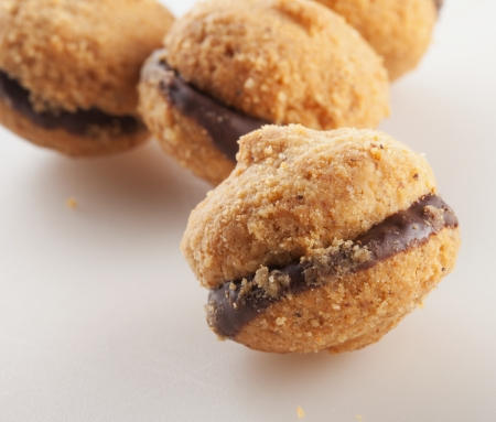 kiss biscuits: Baci di dama, typical Italian biscuits, over white background Stock Photo