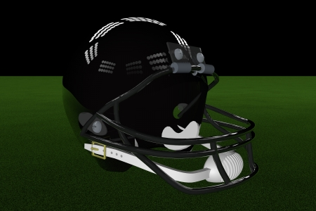 Black football helmet in the middle of field, with stadium lights photo