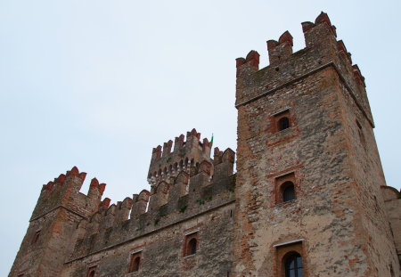 sirmione: Beautiful castle of Sirmione, Italy, extending over the lake Editorial