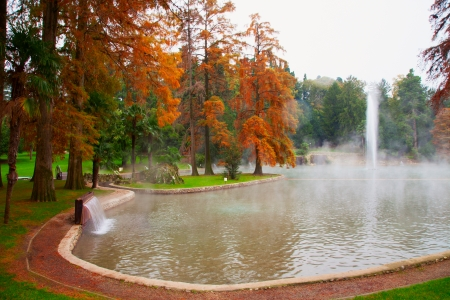 Big high fountain in the middle of a smokey thermal lake Stock Photo