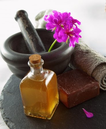 turkish bath: Soap, oil, flower and mortar over black stone