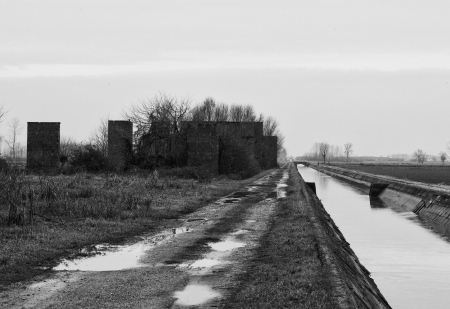 Ruins of old industrial building in the fields, black and white