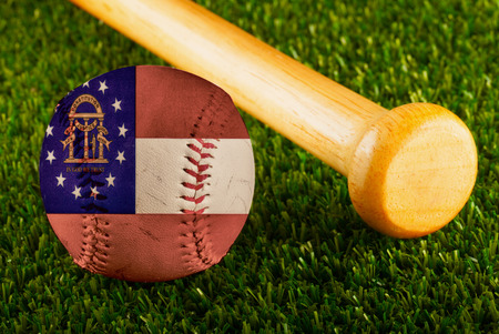 Baseball with Georgia flag and bat over a background of green grass Stock Photo