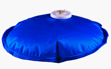 w�rmflasche: Blue electric hot water bag over pink background