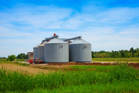 Great silos for agricultural commodities, under blue sky