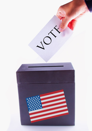 Urn for vote, with male hand posting vote and US banner photo