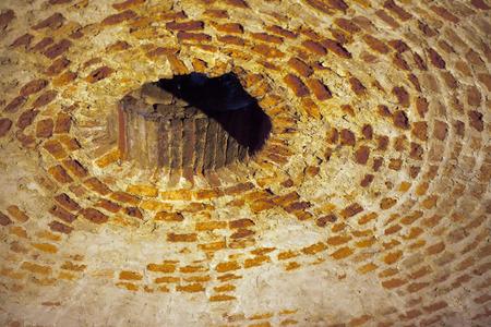 Entrance hole of an old bricks cistern