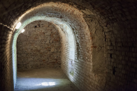 tunneling: Subterranean bricks gallery with windows and electric lights