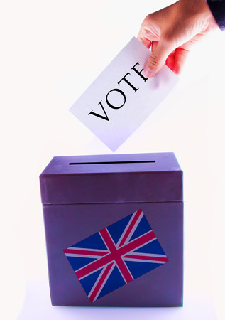 Urn for vote, with male hand posting vote and UK banner photo