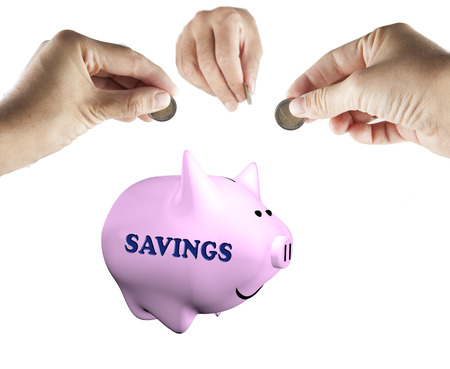 Male hands bringing money to a piggy bank, isolated over white, with word Savings on the side photo